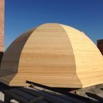 Закончили обшивку деревом металлического каркаса главного купола